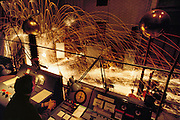 Simulated lightning strike to a TV antenna wire, exploding the wire. Institution for Hopspänningsforkning, Husbyborg, Uppsala, Sweden. Engineer - Eric Löfberg. (1991).Lightning occurs when a large electrical charge builds up in a cloud, probably due to the friction of water and ice particles. The charge induces an opposite charge on the ground, and a few leader electrons travel to the ground. When one makes contact, there is a huge backflow of energy up the path of the electron. This produces a bright flash of light, and temperatures of up to 30,000 degrees Celsius.
