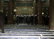 CHINA, XI'AN: Chinese Muslim men praying inside the Great Mosque of Xi'an.