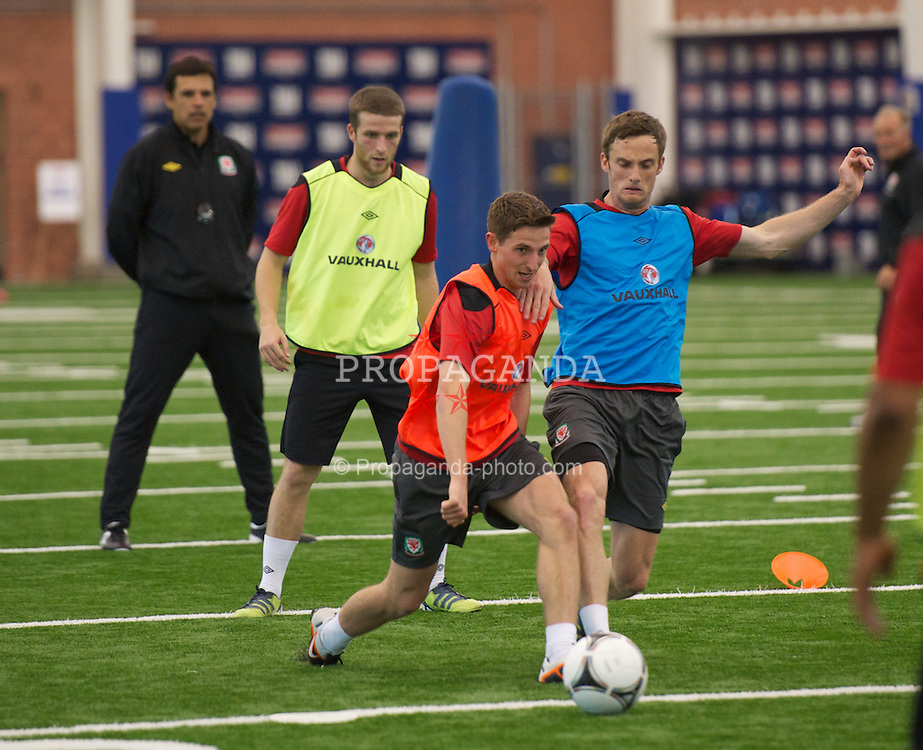 RUTHERFORD, NEW JERSEY, USA - Thursday, May 24, 2012: Wales' Joe Allen and Andy King during a training session inside the New York Giants' Timex Center (sic) ahead of the friendly match against Mexico. (Pic by David Rawcliffe/Propaganda)