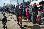 March 4, 2016, Idomeni, Greece. Refugees are queing for food, which can take up to 4 hours. 12.000 refugees are stuck at the Idomeni border crossing in Greece  after Macedonia closed the border.  New arrivals come in every day, making living conditions tough.(Steven Wassenaar/Polaris)