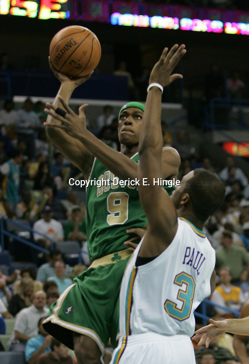 Boston Celtics guard Rajon Rondo #9 shoots over New Orleans Hornets guard Chris Paul #3 during the first quarter of their NBA game on March 22, 2008 at the New Orleans Arena in New Orleans, Louisiana. The New Orleans Hornets defeated the Boston Celtics 113-106.