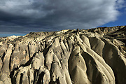 Eroded rocks in the Goreme Valley, in Goreme National Park, between Goreme and Uchisar, in Nevsehir province, Cappadocia, Central Anatolia, Turkey. The rock formations here were made by erosion of the soft volcanic tuff created by ash from volcanic eruptions millions of years ago. The Goreme Valley also contains cave dwellings, underground towns and churches, carved out of the rock in the Byzantine period. This area forms part of the Goreme National Park and the Rock Sites of Cappadocia UNESCO World Heritage Site. Picture by Manuel Cohen