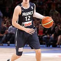 15 July 2012: Nando De Colo of Team France brings the ball upcourt during a pre-Olympic exhibition game won 75-70 by Spain over France, at the Palais Omnisports de Paris Bercy, in Paris, France.