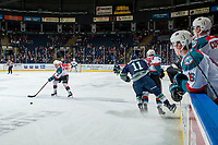 KELOWNA, CANADA - FEBRUARY 23: Holden Katzalay #11 of the Seattle Thunderbirds checks Erik Gardiner #12 of the Kelowna Rockets at the boards during first period  on February 23, 2018 at Prospera Place in Kelowna, British Columbia, Canada.  (Photo by Marissa Baecker/Shoot the Breeze)  *** Local Caption ***