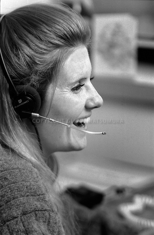 Office worker wearing telephone headset at Second Harvest Food Bank
