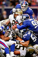 Client: Icon SMI. Aaron Brooks of the New Orleans Saints is gang tackled by the Giants defense during the Saints 21-13 loss to the New York Giants at Giants Stadium in East Rutherford, New Jersey. (Photo by Robert Falcetti)