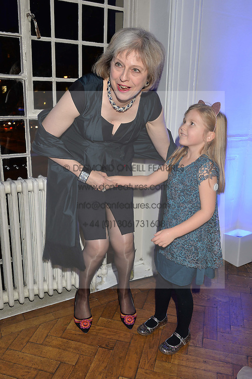 The Home Secretary THERESA MAY and ALIENA WIGAN at the Sugarplum Dinner in aid Sugarplum Children a charity supporting children with type 1 diabetes and raising funds for JDRF, the world's leading type 1 diabetes research charity held at One Marylebone, London on 18th November 2015.