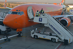 09-07-18 Lanseria Airport. Ground crew and airport staff busy near a Mango Airline plane while travellers disembark. Picture: Karen Sandison/African News Agency (ANA)..
