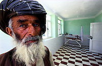 JURM HOSPITAL, 28 July 2005..The keeper of Jurm Hospital is standing in 'what will be' the maternity ward...This two-floor hospital has been fully refurbished by WHO and UNFPA. The building has not been used for the last 2/3 years because, apparently, there are no doctors. ....According to United Nations Population Fund, Afghanistan has among the world?s highest rates of maternal mortality, and Badakhshan has the highest rates ever recorded anywhere in the world, with one mother dying in every 15 births. Lack of medical infrastructures is one of the primary causes of maternal mortality.