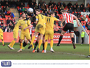 Danny Wright scores his header during the Vanarama National League match between Cheltenham Town and Bromley at Whaddon Road, Cheltenham, England on 30 January 2016. Photo by Antony Thompson.
