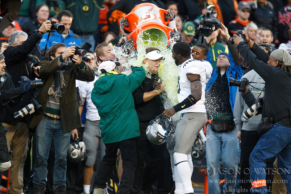December 4, 2010; Corvallis, OR, USA;  Oregon Ducks head coach Chip Kelly has gatorade poured on him by his team during the fourth quarter against the Oregon State Beavers at Reser Stadium.  Oregon defeated Oregon State 37-20.