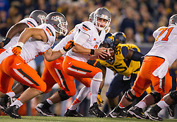 Oct 10, 2015; Morgantown, WV, USA; Oklahoma State Cowboys quarterback Mason Rudolph drops back to hand the ball off during the first quarter against the West Virginia Mountaineers at Milan Puskar Stadium. Mandatory Credit: Ben Queen-USA TODAY Sports