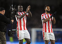 Football - 2017 / 2018 Premier League - Brighton & Hove Albion vs. Stoke City<br /> <br /> Stoke goalscorers, Kurt Zouma and Maxim Choupo - Moting applause the stoke fans after the match, at The Amex.<br /> <br /> COLORSPORT/ANDREW COWIE