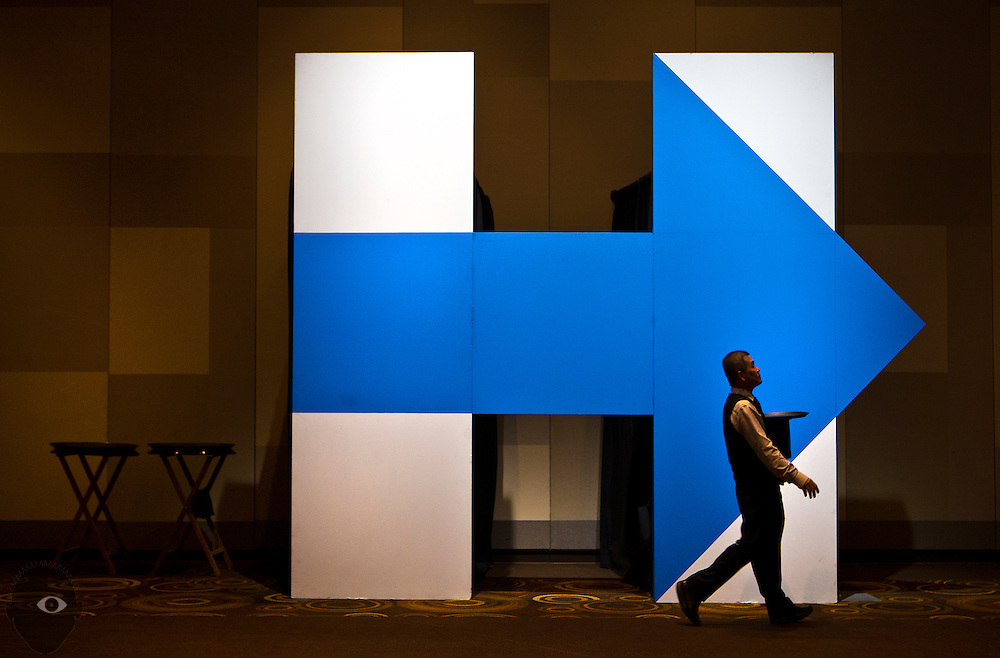 """A waiter passes a giant Hillary """"H"""" as the Nevada State Democratic Party begins to host its 2016 election night watch party with Hillary for Nevada, Catherine Cortez Masto for Senate, and down-ballot Democratic candidates in Southern Nevada at ARIA Resort and Casino on Tuesday, Nov. 8, 2016. L.E. Baskow"""