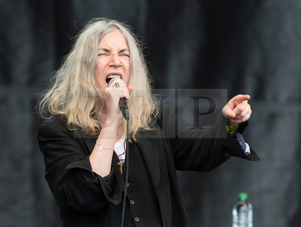 © Licensed to London News Pictures. 28/06/2015. Pilton, UK. Patti Smith performing at Glastonbury Festival 2015 on Sunday Day 5 of the festival on the The Pyramid Stage stage.  This years headline acts include Kanye West, The Who and Florence and the Machine, the latter being upgraded in the bill to replace original headline act Foo Fighters.  Photo credit: Richard Isaac/LNP