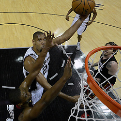 Jun 13, 2013; San Antonio, TX, USA; San Antonio Spurs power forward Tim Duncan (21) shoots against Miami Heat center Chris Bosh (1) during the second half of game four of the 2013 NBA Finals at the AT&T Center. The Miami Heat defeated the San Antonio Spurs 109-93. Mandatory Credit: Derick E. Hingle-USA TODAY Sports