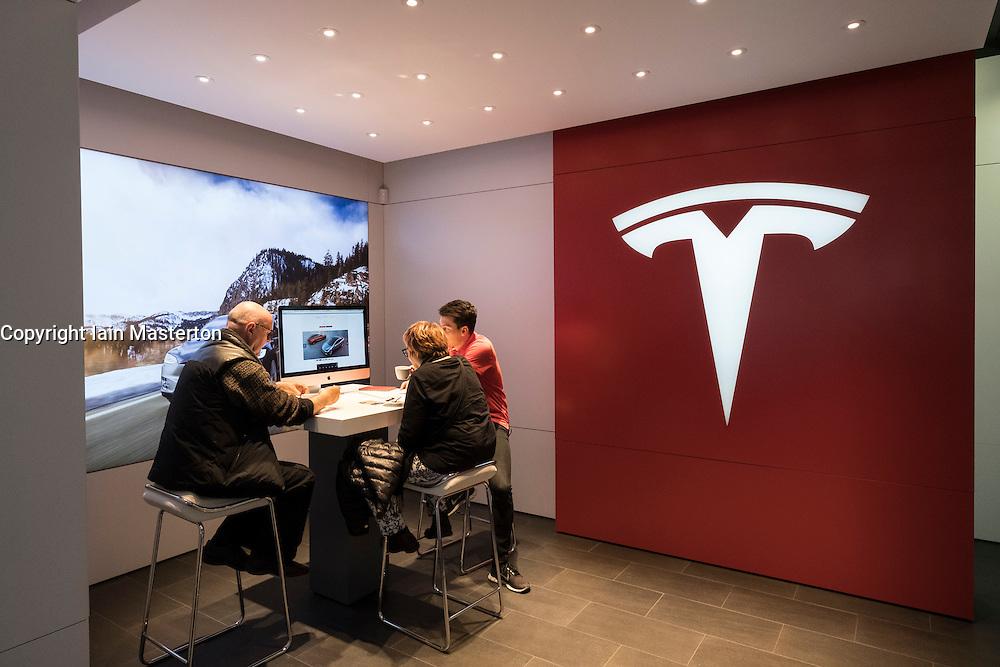 Customers inside Tesla electric car showroom on Kurfurstendamm, Kudamm, in Charlottenburg, Berlin, Germany