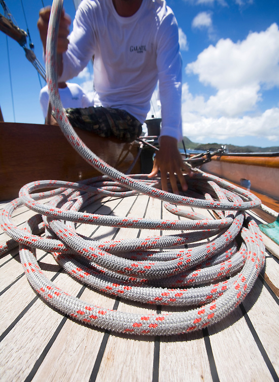 Coiling a rope on deck during the 2008 Antigua Classic Yacht Regatta . This race is one of the worlds most prestigious traditional yacht races. It takes place annually off the cost of Antigua in the British West Indies. Antigua is a yachting haven, historically a british navy base in the times of Nelson.
