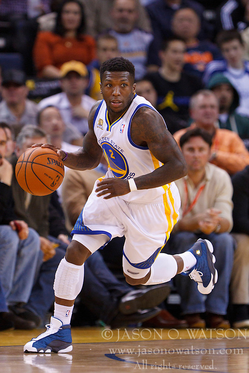 Feb 2, 2012; Oakland, CA, USA; Golden State Warriors point guard Nate Robinson (2) dribbles the ball against the Utah Jazz during the second quarter at Oracle Arena. Golden State defeated Utah 119-101. Mandatory Credit: Jason O. Watson-US PRESSWIRE