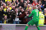 Watford fans with Heurelho Gomes during the Sky Bet Championship match between Brighton and Hove Albion and Watford at the American Express Community Stadium, Brighton and Hove, England on 25 April 2015.