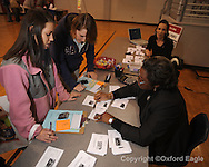 Lafayette High students (l. to r.) Megan Wootten and Kayla Mottz meet with realtor Martha Thompson as part of career day at the school in Oxford, Miss. on Wednesday, February 24, 2010.