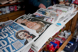 © Licensed to London News Pictures. 09/04/2013. London, UK. The day after the death of former British Prime Minister Baroness Thatcher newspapers and magazines bearing her face are seen outside a newsagents in London today (09/04/2013). Photo credit: Matt Cetti-Roberts/LNP