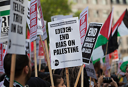 Image ©Licensed to i-Images Picture Agency. 15/07/2014. London, United Kingdom. Demonstration against BBC Israel-Palestine reporting. Protesters hold banners against the BBC in a demonstration against their way of reporting the conflict between Israel-Palestine conflict. the BBC. Picture by Daniel Leal-Olivas / i-Images