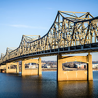 Photo of Murray Baker Bridge in Peoria Illinois. The Murray Baker Bridge spans the Illinois River connecting Peoria with East Peoria as Interstate I-74. Built in 1958, the bridge is named after Murray Baker who started a company that would later become Caterpillar.