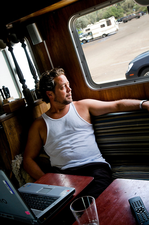 Architectual drafter Joel Paschall lives and works in his motorhome in a parking lot by Mission Bay, San Diego after being hit by the economic crisis...Photographer: Chris Maluszynski /MOMENT