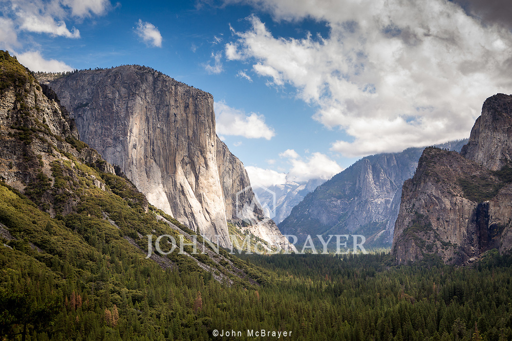 El Capitan stands tall over the valley in Yosemite.  © John McBrayer