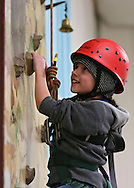 Emma Dworzynski, 9, of Robins works her way up the climbing wall during the Retreat & Refresh Stroke Camp at Camp Courageous in Monticello on Saturday, April 20, 2013.