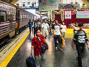 "03 JANUARY 2017 - BANGKOK, THAILAND: Passengers get off a train that just arrived at Hua Lamphong Train Station in Bangkok Tuesday. Travelers flocked to Bangkok bus and train stations Tuesday, the last day of the long New Year's weekend in Thailand. The New Year holiday in Thailand is called the ""seven deadly days"" because of the number of fatal highway and traffic accidents. As of Monday Jan 2, 367 people died in highway accidents over the New Year holiday in Thailand, a 25.7% increase over the same period in 2016.          PHOTO BY JACK KURTZ"