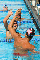 Swimmers High-Fiving