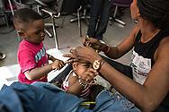 Septembre 2014. Paris. Reportage dans le salon de coiffure Dallas du 57 boulevard de Strasbourg à Paris où 18 salariés sont en grève depuis juillet 2014 pour reclamer des salaires et des contrats de travail. September 2014 Paris. Report in the hair salon Dallas, 57 Boulevard de Strasbourg in Paris, where 18 employees have been on strike since July 2014 order to claim wages and labor contracts.