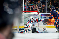 KELOWNA, CANADA - DECEMBER 29: Roman Basran #30 of the Kelowna Rockets makes a save against the Kamloops Blazers  on December 29, 2018 at Prospera Place in Kelowna, British Columbia, Canada.  (Photo by Marissa Baecker/Shoot the Breeze)