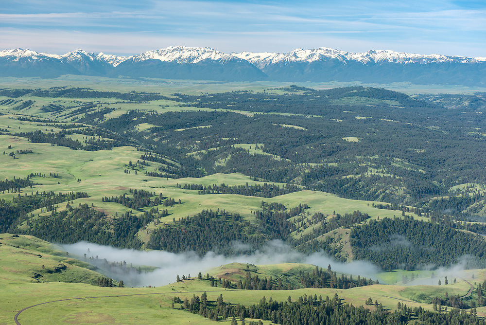 Morning fog in Chesnimus Creek with the Wallowa Valley and Wallowa Mountains in the distance, Northeast Oregon.