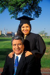 Stock photo of a girl with her father at her graduation