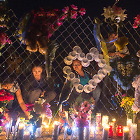Hundreds of people pay their respects to Ashlynne Mike at a roadside memorial, Tuesday, near mile marker 13 on Navajo Route 36 in San Juan where Ashlynne and her brother Ian Mike were abducted Monday.