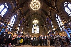 © Licensed to London News Pictures .02/09/2015 . Manchester , UK . Listening to the speeches . Event and signing of a memorandum of understanding to mark partnerships between industry and the NHS , at the Great Hall at Manchester Town Hall . Service providers aim to improve access to cutting edge treatments within the NHS to patients in Greater Manchester , as part of the continuing devolution of the NHS in the region . Photo credit : Joel Goodman/LNP