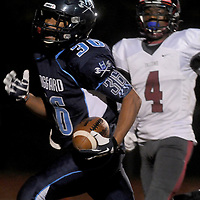 Hoggard Keevin Thompson rushes past South Central High School's Caleb Edwards for a touchdown in the first round of football playoffs Friday November 14, 2014. (Jason A. Frizzelle)