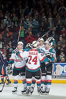 KELOWNA, CANADA - FEBRUARY 6: Dillon Dube #19, Gage Quinney #20, Tyson Baillie #24 and Devante Stephens #21 of Kelowna Rockets celebrate a goal against the Kamloops Blazers during first period on February 6, 2015 at Prospera Place in Kelowna, British Columbia, Canada.  (Photo by Marissa Baecker/Shoot the Breeze)  *** Local Caption *** Tyson Baillie; Devante Stephens; Dillon Dube; Gage Quinney;