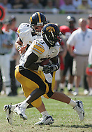 01 SEPTEMBER 2007: Iowa quarterback Jake Christensen (6) hands the ball off to running back Albert Young (21) in Iowa's 16-3 win over Northern Illinois at Soldiers Field in Chicago, Illinois on September 1, 2007.
