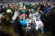 January 24, 2016: Carolina Panthers vs Arizona Cardinals. Panthers players pray with Cardinals players