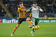 Kieffer Moore of Barnsley battles with Michael Hector of Hull City during the EFL Sky Bet Championship match between Hull City and Barnsley at the KCOM Stadium, Kingston upon Hull, England on 27 February 2018. Picture by Craig Zadoroznyj.