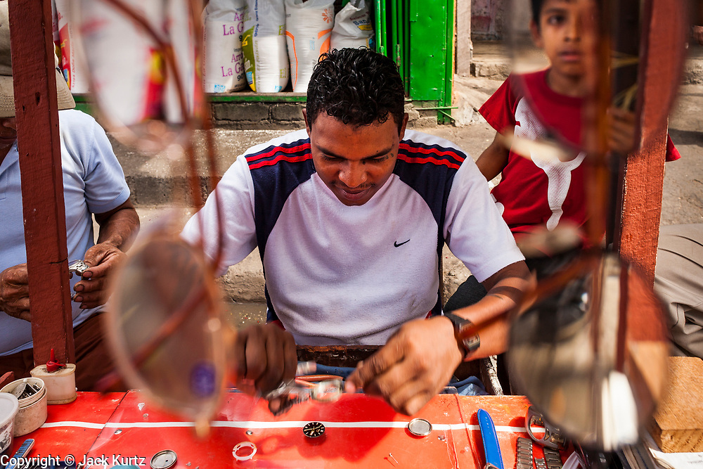 08 JANUARY 2007 - MANAGUA, NICARAGUA:  An eyeglass and watch repair stand in Mercado Oriental, the main market that serves Managua, Nicaragua. The market encompasses dozens of square blocks and is the largest market in Central America.  Photo by Jack Kurtz