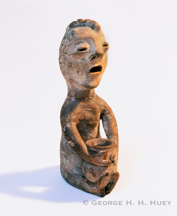 0194-1001 ~ Copyright: George H.H. Huey ~ Rain god figurine.  Circa 1890's.  Tesuque Pueblo, New Mexico.