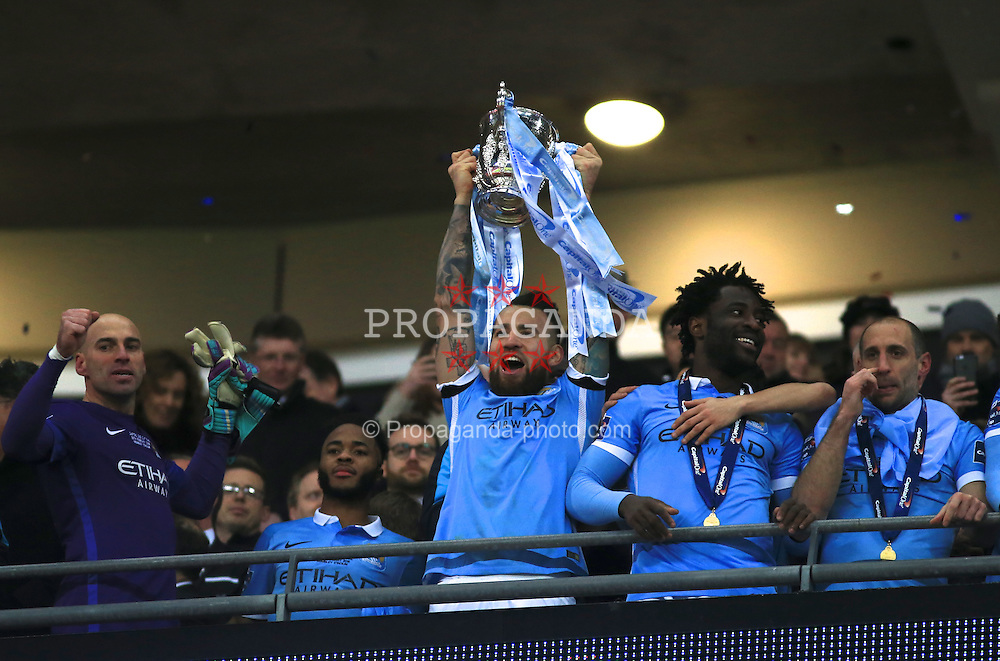 LONDON, ENGLAND - Sunday, February 28, 2016: Manchester City's Nicolas Otamendi lifts the Cup after beating Liverpool on penalties during the Football League Cup Final match at Wembley Stadium. (Pic by John Walton/Pool/Propaganda)