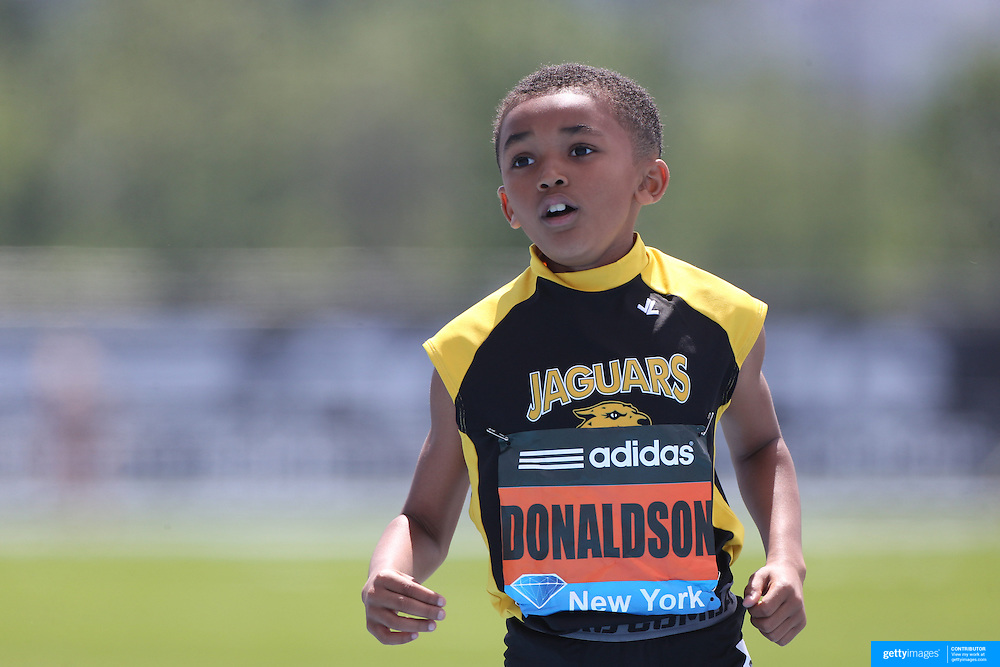 Xavier Donaldson, USA, winning the Boys' Fastest Kid in New York 100m during the Diamond League Adidas Grand Prix at Icahn Stadium, Randall's Island, Manhattan, New York, USA. 14th June 2014. Photo Tim Clayton