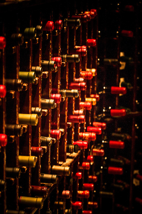 bottles of red wine in a cellar