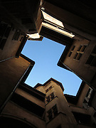 Looking up at the sky from within a courtyard in the Traboules (alleyways) in Lyon - the shapes look a bit like a lion